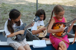 3 mandolins in a boat, from the Bearfoot Bluegrass Camp for Kids.