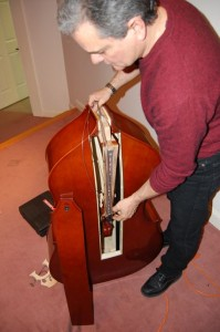 Charlie Chadwick of John Jorgenson's group demonstrates his folding bass.